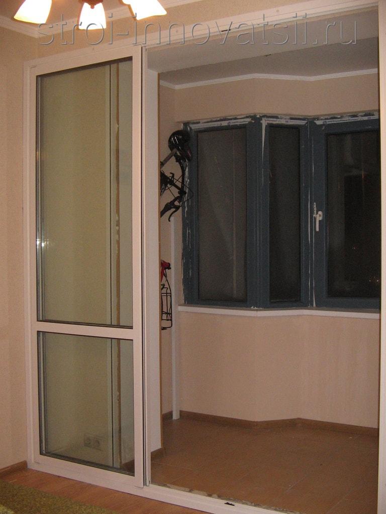 """Дверь на балкон стеклянная компания """"kelman""""."""