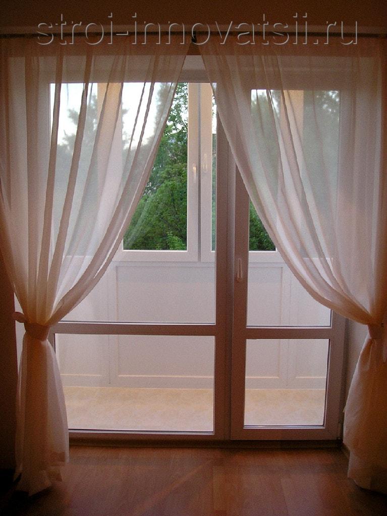 """Раздвижные стеклянные двери на балкон компания """"kelman""""."""