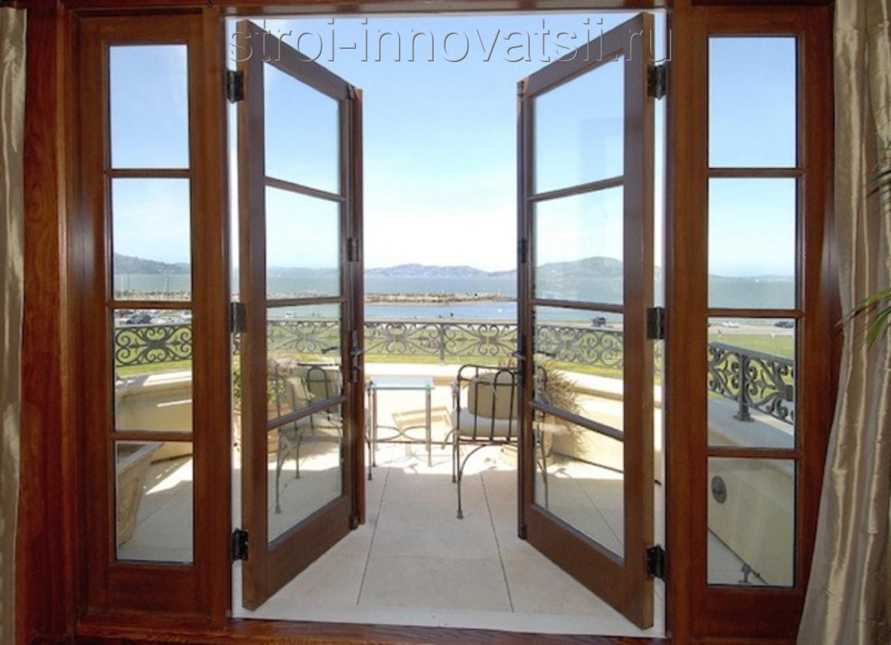 """Панорамные стеклянные двери компания """"kelman""""."""
